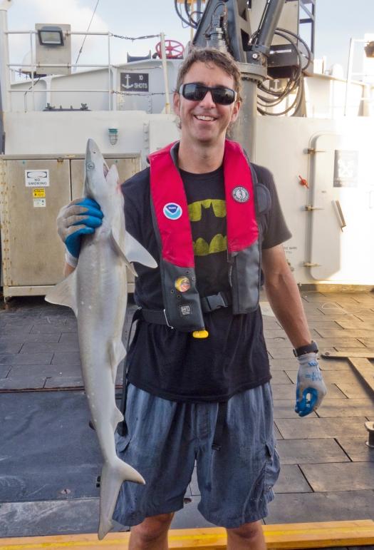 Holding a sharpnose shark