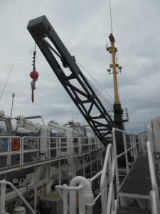 The large crane at the stern (back) of the ship.