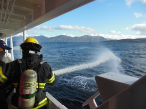 ENS McKay practicing with the fire hoses.
