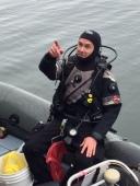 Dr. Stone prepares to dive