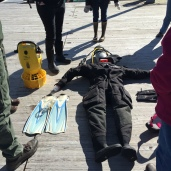 Drysuit (right) and yellow underwater scooter