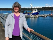 Mary in Bartlett Cove, with the Norseman II in the background