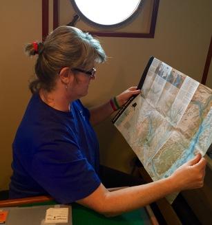 Mary reading NPS brochure