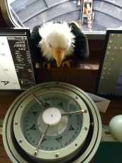Qanuk examines a big compass
