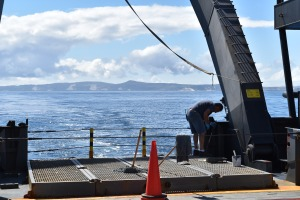 Painting the deck of NOAA Ship Shimada