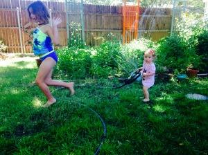 The girls 'water' the garden
