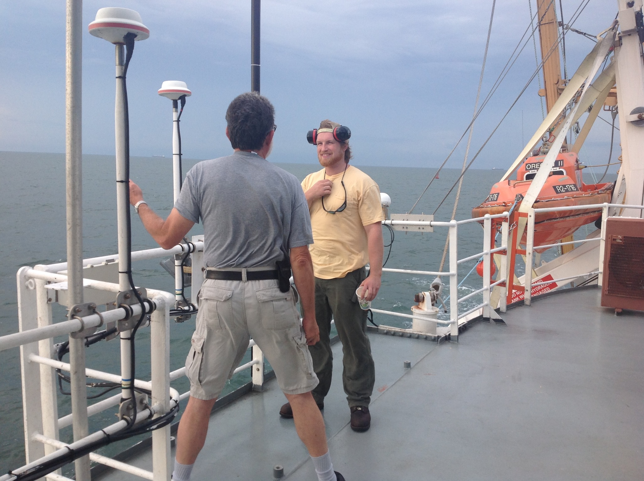 roy-tolliver-and-sam-on-the-flying-bridge-as-we-moved-into-the-harbor-at-gulfport-mississippi