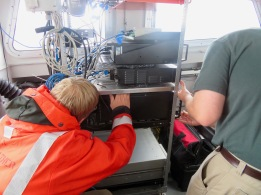 Hydrographer Steve Eykelhoff and ET Sean checking the computers on the small boats