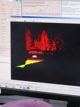Laser image of boat with trees behind