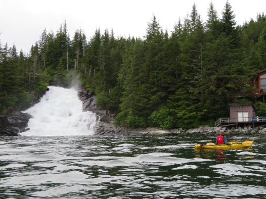 Kayaking by the waterfall in Warm Spring Bay