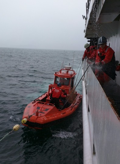 Fairweather's fast rescue boat pulled alongside and was tied up to us.