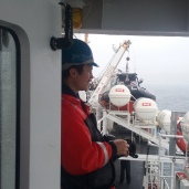 Ops Officer LT Manda taking photos of the Oscar Dyson - another ship in the NOAA fleet