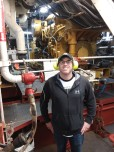 Tom Jenkins standing in engine room of NOAA ship Bigelow