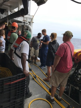 A team on deck working to get the Mohawk, a Remotely Operated Vehicle ready to deploy