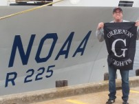 Standing in front of the ship with my school district Greenon flag