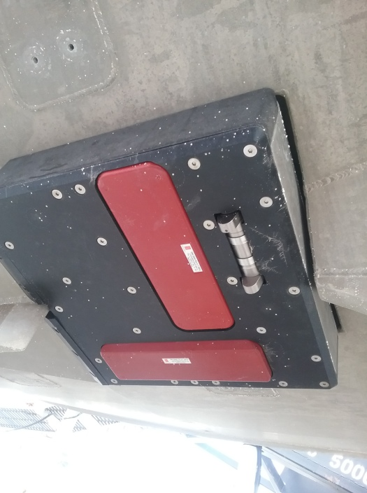 A multi-beam sonar in the Mills Cross orientation on the underside of a launch boat