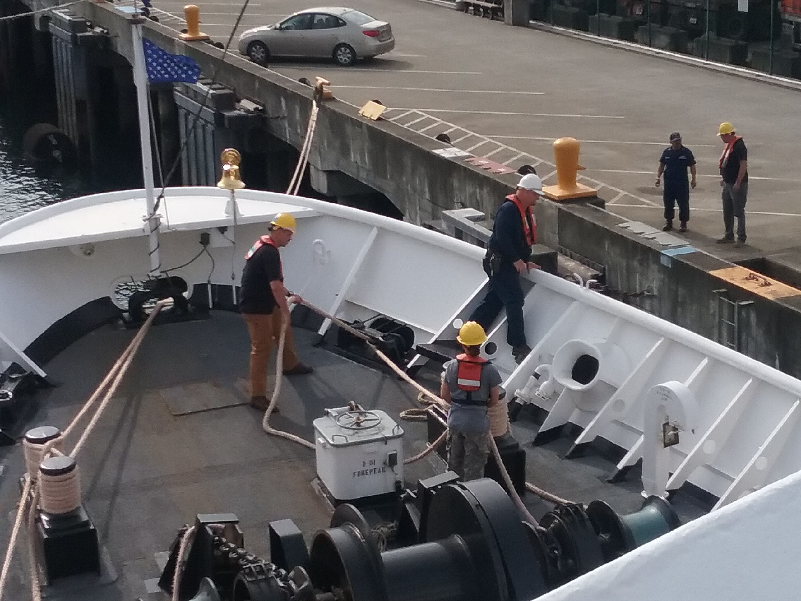 The deck crew preparing to leave port
