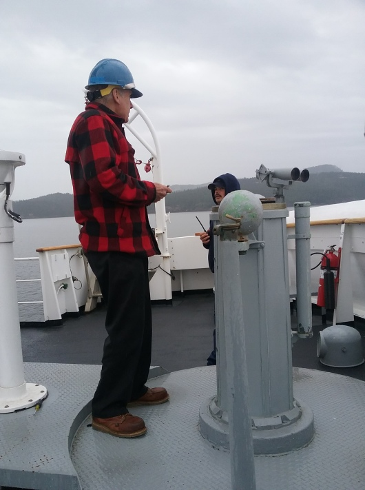 Captain Keith Sternberg swinging the compass from the flying bridge