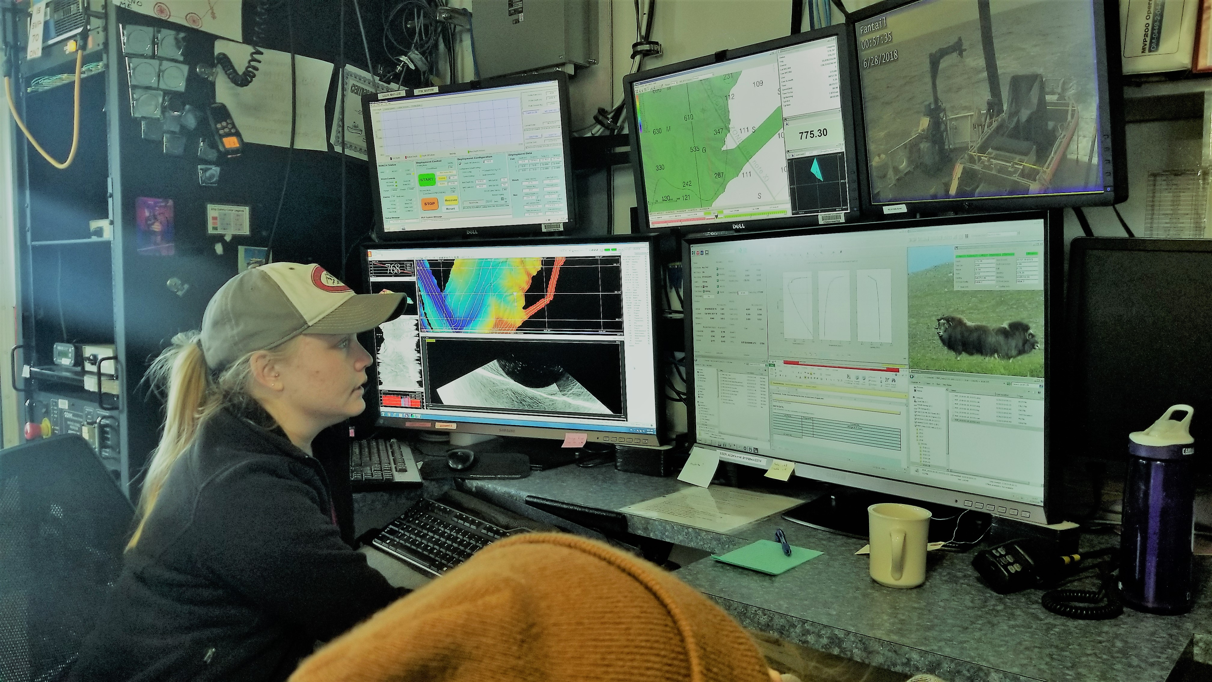 Ali Johnson monitoring 5 screens to make sure the sonar mapping is done correctly.