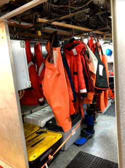 "Waterproof gear hanging in the ""ready room""."