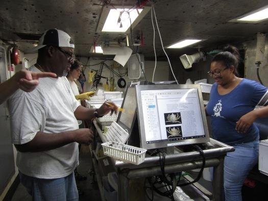 Alonzo Hamilton, left, and Taniya Wallace, right, enter species into FSCS.