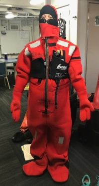 The immersion suits would be used to keep warm in the event we had to abandon ship