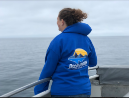 TAS Lacee Sherman wearing her NOAA Ship Oscar Dyson hoodie while visiting the ocean only 4 days after returning home.