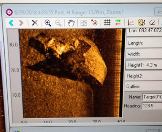 "In the early morning, the sidescan sonar picked up the image of an incorrectly charted shipwreck. Height is estimated using the ""shadow"" of the wreck."
