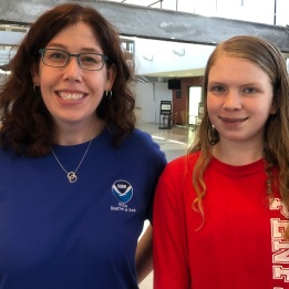 A teacher and student at the airport.