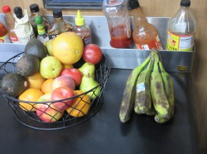 A fruit basket and a bunch of bananas