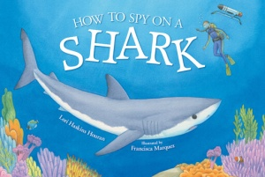 The cover of a children's nonfiction book shows a scientist diving near a shark and coral reef with an autonomous underwater vehicle in the background.