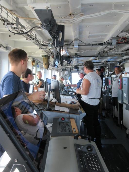 A pre-dive briefing on the bridge