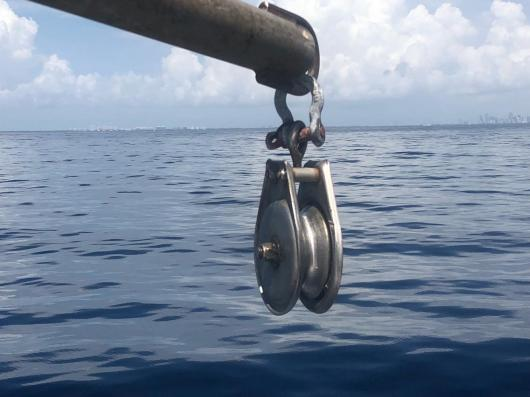 A pulley in front of water