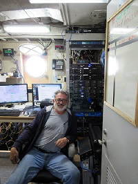 Chief Electronics Technician Roy Toliver in his office on the Oregon II.