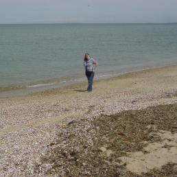 Me as an adult on the beach.