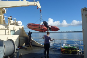 Dan, Andy, and Morgan lowering a skiff for our trip to Middleton Island.