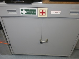 A metal first aid cabinet.