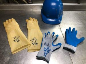 Two pairs of gloves and a hard hat