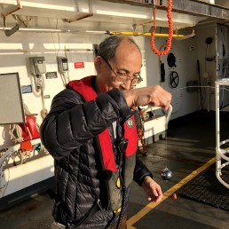 "Scientist Dezhang Chu prepares the ""magic sphere"" before dropping it in the water for calibration"