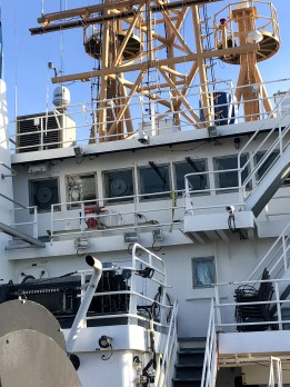 A view looking up from the deck at the top vessel