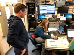 Chief Scientist Rebecca Thomas analyzes the picture from the acoustic transmitter to give the bridge a location to fish.