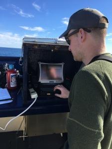Bird biologist Dan Cushing entering data along the Middleton Line.