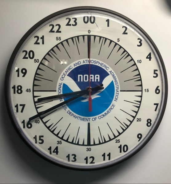 A 24-hour analog clock.