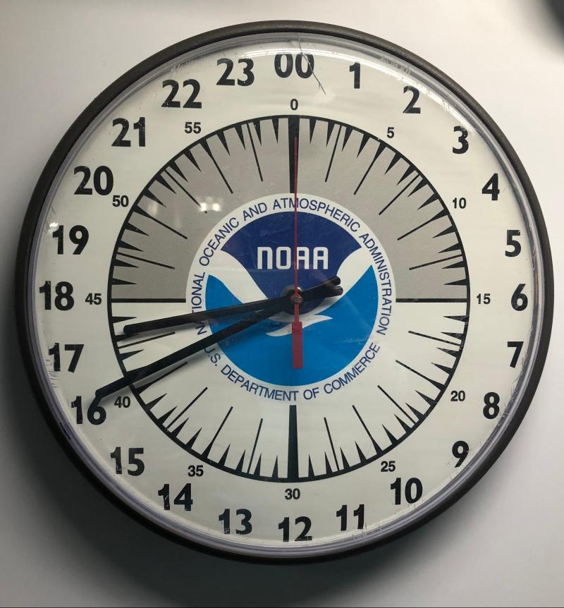 A 24-hour analog clock.