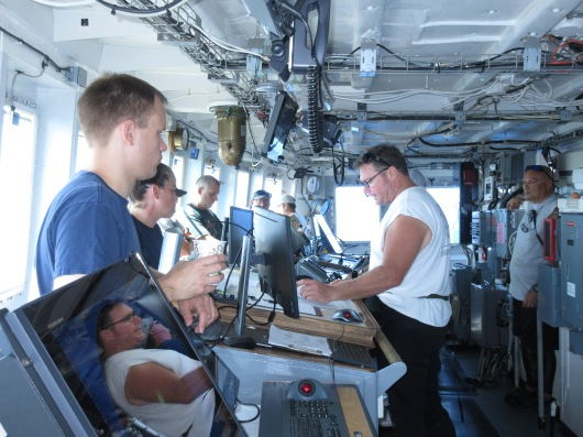 A pre-dive safety briefing takes place on the ship's bridge.