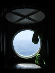View of the water through the galley sink porthole.