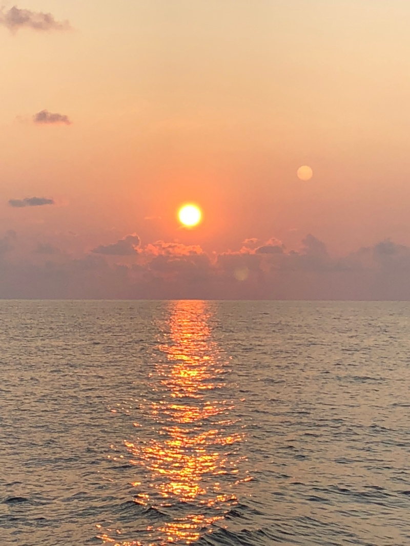 A view of the sunrise on the horizon