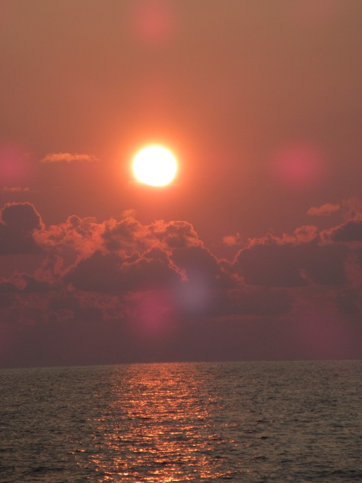 The sun rises over the Gulf of Mexico.