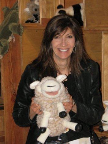 Erica holding a stuffed lamb