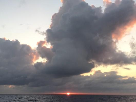 Sun sets over the ocean